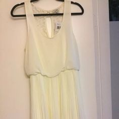 Guess pleated dress Brand new with tags attached,soft creamy color Guess Dresses Midi