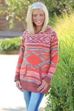 """Our Tribe Has Spoken Sweater with Hood is made of 60% Cotton and 40% Acrylic and measures approximately 32"""" long from shoulder to hem.  This sweater is available in sizes Small-2X."""