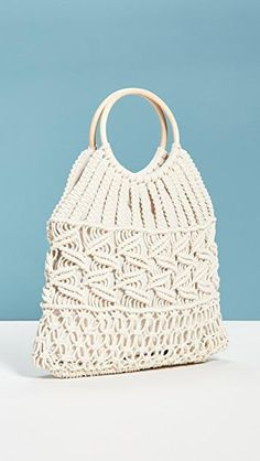 Fabric: Woven canvas Wood ring handles Linen lining Magnetic snap Patch interior pocket Weight: / Imported, China Measurements Height: / Length: / Depth: / Handle drop: / Buy Hats, Macrame Purse, Macrame Design, Ancient Greek Sandals, Wood Rings, Macrame Patterns, China Fashion, Knitted Bags, Small Bags