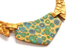 Green gold bib statement necklace Klimt inspired polymer clay necklace circles art deco and Freyville style fashion necklace. $48.95, via Etsy.