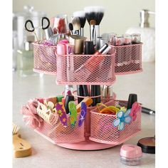 Charlotte Cosmetic Carousel in Pink. i like what i have better for limited counter space but this would be soo cute for a teenagers room/bathroom