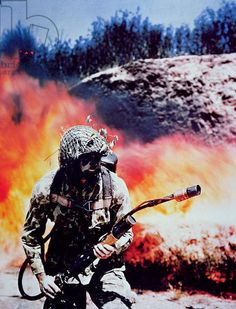 US Marine operates flamethrower, Battle of Guadalcanal, August 1942