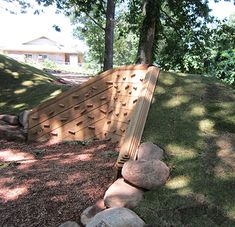 Climbing wall on slope/retaining wall. From Natural Playgrounds Store.