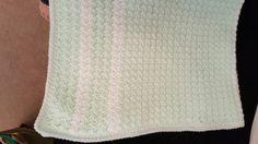 Mint green baby blanket.