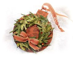 Kids could cut out a basic ornament shape, then glue pieces of ripped green paper in a wreath shape, attach little beads, and a bow.