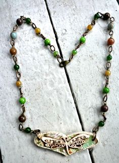 Dragonfly stretched heart pendant. Vintaj chain. Gemstones. Gemstone & dragonfly necklace. Green, brown, cream, light green, blue.. $45.00, via Etsy.