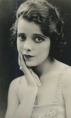 ALMA RUBENS (1897-1931) began her career in the mid 1910s. Quickly rose to stardom in 1916 after appearing opposite Douglas Fairbanks in The Half Breed. For the remainder of the decade, she appeared in supporting roles in comedies and drama. In the 1920s, Rubens developed a drug addiction which eventually ended her career. She died of lobar pneumonia and bronchitis shortly after being arrested for cocaine possession in early January 1931.
