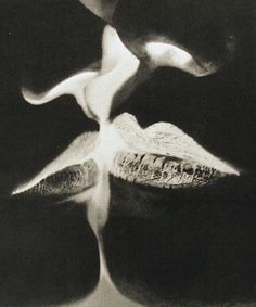Man Ray - The Kiss      Negative Kiss by Man Ray1935