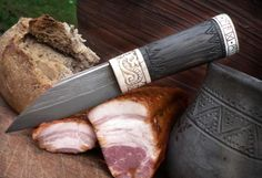 """Fliccebana by Gullin Bursti. Saxon seax, mead hall utility which surely wont loose any fight for the best part of bacon. Thus its name - Fliccebana - bacon slayer. Blade is welded from old file and wrought iron. spine is inlayed with silver wire line. Handle is antler, bog oak (oaken wood, buried a long time in swamp, without oxygen) and silver cap with runic inscription in Old English """"Gullinbursti made me""""."""