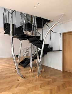 Less-Than-Stable Look Though it looks like something from a Tim Burton movie, Vincent Duborg was commissioned to create this three-story, bursting-from-the-floor staircase for a home in London. Let's hope it just looks rickety.