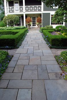 Boxwood w/ Perennials at front entry    Google Image Result for http://www.deborahsilver.com/blog/wp-content/uploads/2009/07/views8.jpg
