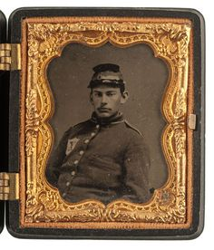 """Civil War Ninth Plate Ruby Ambrotype of a Soldier Wearing a Patch Representing the 10th Legion, 56th New York Infantry. 11/21/2014 - American History: Live Salesroom Auction The soldier wearing a uniform with a large shield patch bearing an """"X"""" for the 10th Legion of the 56th New York Infantry. Housed in The Camp SceneUnion case (Krainik-368). Condition: Plate and case in very good condition."""