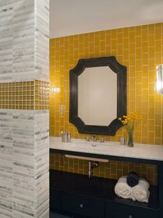 Go vertical. When youre extending tile up the entire wall, consider turning it sideways and emphasizing height and verticality.