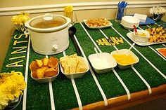 Superbowl party ideas. Buy a piece of cheap turf for a table runner and make lines with white tape. #GoHawks