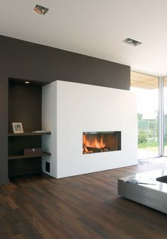 "Fireplace in cool ""box"" recessed dark shelves"
