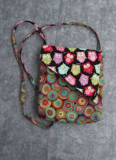 This handmade over the shoulder bag has 4 inside pockets for organization. It also has one hidden pocket on the outside. Handmade by BrooksBeautifulCreations