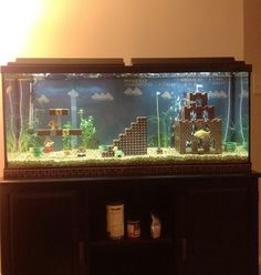 Super Mario aquarium, I want this. I love super mario Lego Super Mario, Super Mario Bros, Lego Mario, Mario Toys, Deco Gamer, Georg Christoph Lichtenberg, Fire Flower, Ideias Diy, Betta Fish