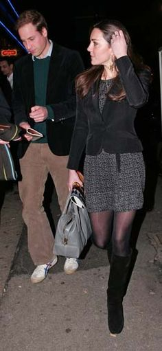 """Duchess Catherine in gray and black patterned dress, black blazer, black suede boots, and gray Tod D-styling """"Mauletto Medio"""" handbag attending a performance of """"War Horses"""" at the New London Theater with Prince William, December 2009"""