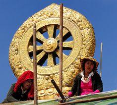 Wheel of Dharma, Tibetan ladies renovate Sera monastery.