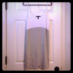 "Victoria's Secret Slip Dress NWOT Lightweight, 18"" from waist.  I purchased this slip online for a certain dress and it didn't end up working with it! It is white and grey, has a v neck cut and adjustable straps. Victoria's Secret Dresses"
