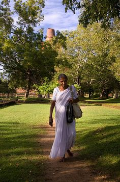 Woman walking between temples, Anuradhapura, Sri Lanka Old Person, Holiday Travel, Im In Love, Family Life, Temples, Sri Lanka, Places Ive Been, Destinations, Asia