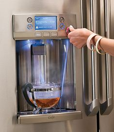 A new GE French-door fridge has its own hot water dispense for tea and includes a formula setting for new parents!