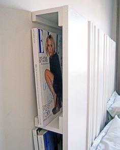 Sängyn päätynä paneli ja takana lehtilokero