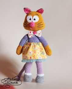 EN: Crochet cat pattern for Olga, the corporate cat. This is a tutorial for how to crochet a cat with 2 skirts. This is an Instant Download Crochet Pattern in ENGLISh, meaning once payment was confirmed by Etsy you will be able to download the file and crochet Olga the cat.  Olga is a corporate cat, who decided it was time to leave the big city life and live a wild life on her own. Yarn used: cotton sport 2. Hook: 2,5 mm Skill level: easy. The end result is about 25 cm tall.  Olga is…