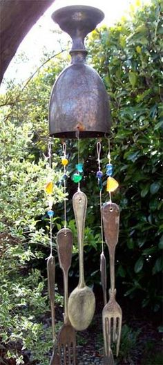 Earth Day in the Garden from a Recycling Artists Perspective.The chime is fashioned out of an old anniversary cup found at a garage sale and hung with flattened silver cutlery is another recycled artwork Patio Pergola, Backyard, Silverware Art, Vintage Cutlery, Diy Wind Chimes, Unique Gardens, Earth Day, Mobiles, Yard Art