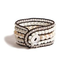 Chunky bracelet with white, clear and PEARL BEADS encased in black wax linen cord, with silver button and hole closure is available through The Noble Collection. #TheNobleCollection #50Shades