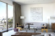 Almost perfect symmetry and strong geometric seating makes for a very clean living room