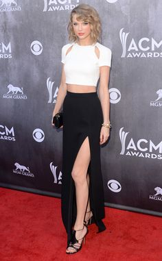 Taylor Swift plays peek-a-boo in a J. Mendel crop top and skirt with slit combo!