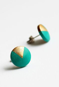 Geomeric stud earrings with gold triangle motif