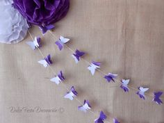 DIY Pompones de papel y guirnaldas Mariposas | Decorar tu casa es facilisimo.com                                                                                                                                                      Más