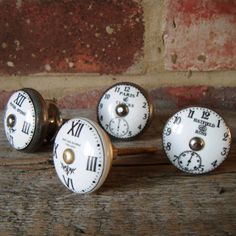 My new kitchen cabinet door nobs!!  LOVE!!!  Just finished installing.    Pushka Ceramic Clock Cupboard Door Knobs, £4.00