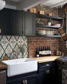 bold kitchen with dark striking colours and unique tiles