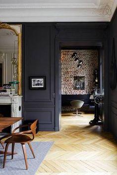 Black, brass, & beautiful wood floors.