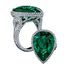 Platinum pear shaped ring, design by Robert Procop, with certified Columbian emerald and diamonds.