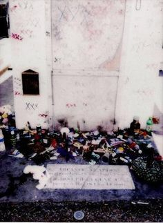 Marie Laveua's Tomb,  she is the famous Voodoo Queen of New Orleans from long ago. People put an x on her tomb as you can see and leave things at her grave, especially plates of food.......people who believe in voodoo....or just want to be on the safe side !