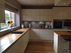My new kitchen/dining room. Lucente cream gloss units, Luxair ceiling hood/extractor, Smeg flush gas hob on island, oak butchers block worktop, Neff slide & hide ovens, microwave & warming drawer, blinds in Malibu feather from Dunelm at home. Walls in Dulux soft truffle.