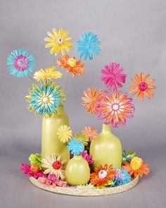 Wow guests with these beautiful straw flowers for your fiesta. Inspired by vintage crafts of the 1960s, these brightly colored crafts make a cheery centerpiece.