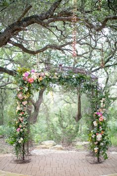floral ceremony arch - photo by The Nichols http://ruffledblog.com/garden-wedding-in-dripping-springs