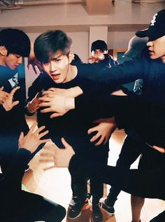monster dance practice - leader suho part (2/6)<<<<< I love how Minseok (the eldest hyung) and Sehun (the maknae) are the ones holding Suho's arms. And then there's just my smol bean Yixing in the back pretending to do magic.