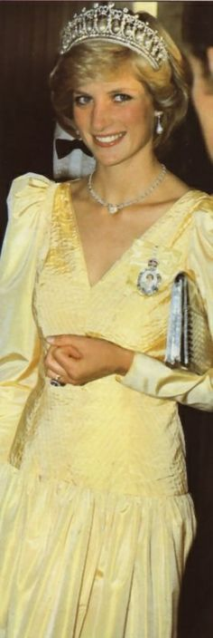 1983-06-23 Diana at the Newfoundland Hotel in St John's, Canada is a vision in a Summer yellow gown. Princess Diana is also wearing the Cambridge Lover's Knot Tiara [with the Pearls in!!] as well as the family order of Queen Elizabeth pin.