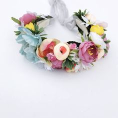 Pastel colors & daisies, bursting with greenery throughout the piece makes for a stunning piece to any outfit this spring & summer. Most items are unique & ooak made in a smoke free environment.  Could pose a choking hazard, do not leave child unattended while product is in use.