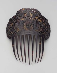 Comb | Museum of Fine Arts, Boston, American 19th century Rather narrow comb of dark tortoise shell with carved top, background of top light with many small pierced stars, design of grape vines in dark relief.