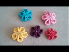 Learn to crochet Kanzashi Flower - Flowers of Japan. These flowers are actually an traditional Japanese ribbon flowers worn in the hair known as Hana Kanzashi. Flower Bouquet Diy, Ribbon Flower Tutorial, Satin Ribbon Flowers, Flower Video, Hand Embroidery Flowers, Burlap Ribbon, Flower Crafts, Flower Making, Easy Crochet