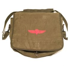 "Canvas messenger bag Authentic reproduction Israeli Army shoulder bag issued to paratroopers for carrying essentials. The color is sort of olive/moss green.  It has ink spots on the top right of the front flap and the main clasp is a little cattywampus, but it still can hook over.   Roomy 3-pocket interior compartment, separate map pocket with storm flap, pen/pencil holders, adjustable strap, snap-ring flap closure, dual hanging rings on back; 15""W x 11""H x 4""D, 2.2 lbsFrom a non smoking…"