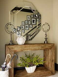 modern, rustic, and earthy.  love it, but I could do without the metal globe spindle things