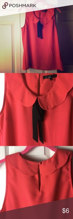 Coral boat neck blouse Cute scalloped boat neck with black bow. Button closure at neck. One small pull on back (never noticed--always paired this with a blazer. Pencil point sized) Always open to offers! C. Luce Tops Blouses